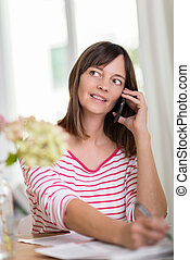 Woman sitting talking on her mobile phone