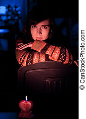 woman sitting with candle