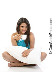 woman sitting with cup of coffee
