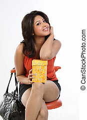 woman sitting with gift box