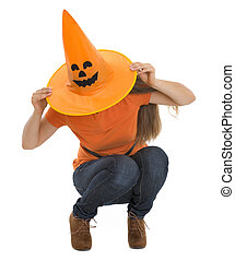 Woman sitting with pulled Halloween hat over head