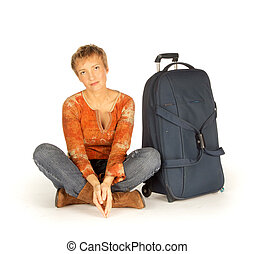 Woman sitting with suitcase on white