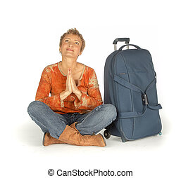 Woman sitting with suitcase