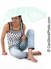 woman sitting with umbrella
