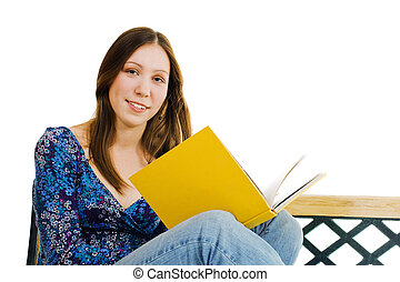 Woman sitting with yellow book