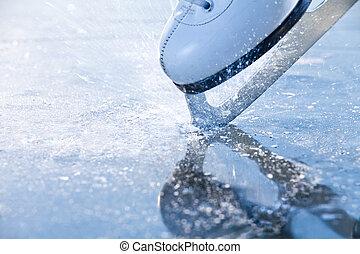 Woman skates braking ice, frazil flying around