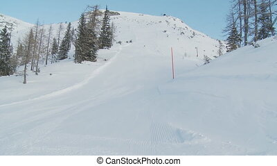 woman skiing alone on slope in the morning