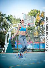 Woman skipping with a jump rope