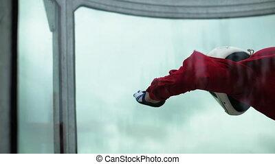 Woman skydiver skydiving in an indoor arena. Indoor sky...