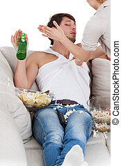 Woman slapping couch potato