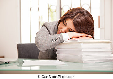 Woman sleeping at the office
