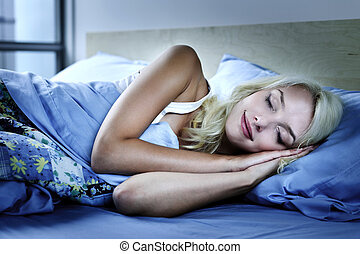 Woman sleeping in bed - Young woman sleeping peacefully at...