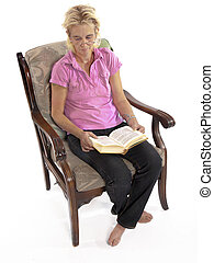 woman sleeping in chair with a book