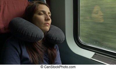 Woman Sleeping in Train