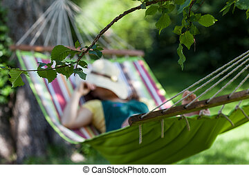 Woman sleeping on a hammock