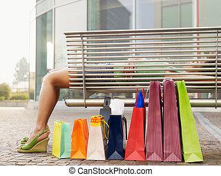 woman sleeping on bench