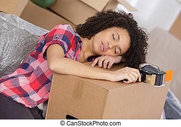 woman sleeping on carton