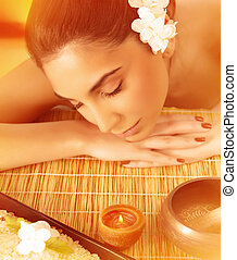 Woman sleeping on massage table