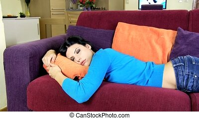 Woman sleeping on sofa relaxing