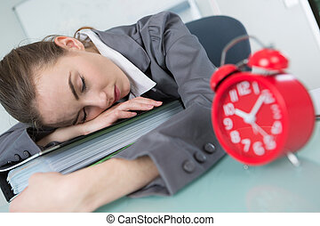 woman sleeping on table while working