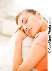 woman sleeping on the couch at home
