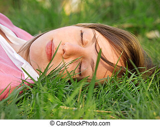 Woman sleeping on the grass