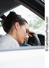Woman sleeping on the wheel