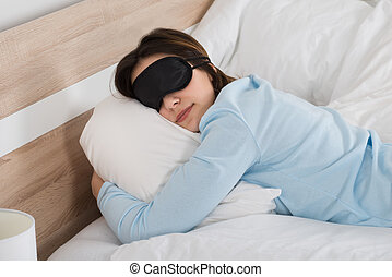 Woman Sleeping With Eyemask On Bed