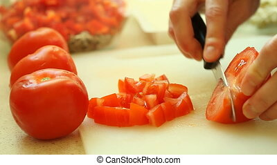 woman slicing tomato