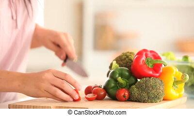 Woman slicing tomatoes