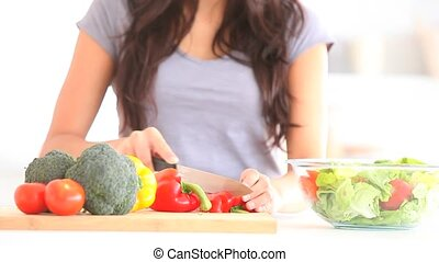 Woman slicing vegetables