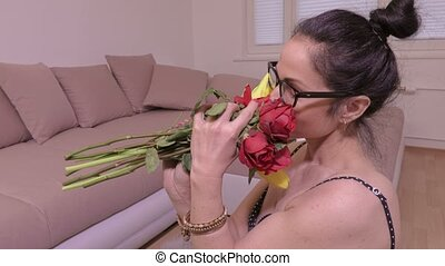 Woman smell flower bouquet