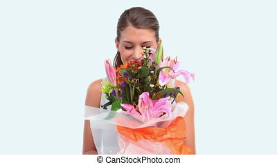 Woman smelling a flower bouquet