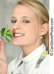 woman smelling a mint leave