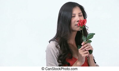 Woman smelling a rose - Video of a woman smelling a rose
