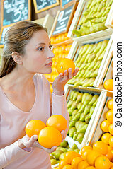 Woman smelling an orange