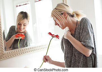 Woman smelling gerbera flower