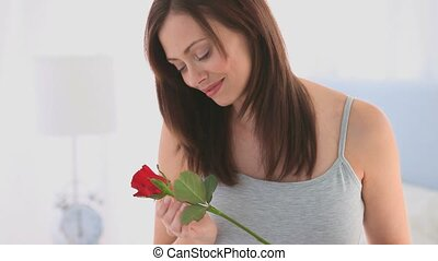 Woman smelling her rose