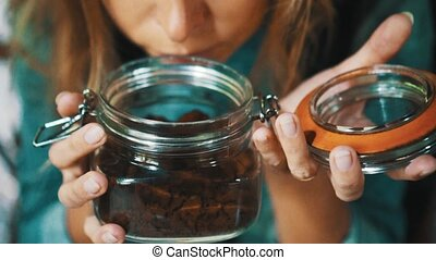 Woman smells fresh coffee - Closeup woman's face smelling...