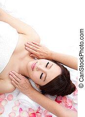 woman smile getting massage on shoulder