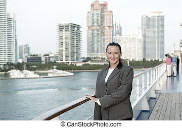 Woman smile in business jacket on shipboard in miami, usa. ...