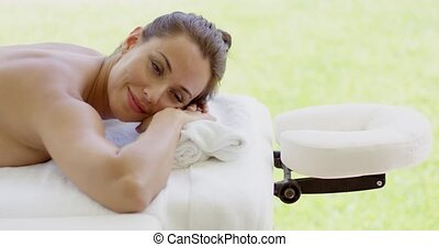 Woman smiles at camera while at spa