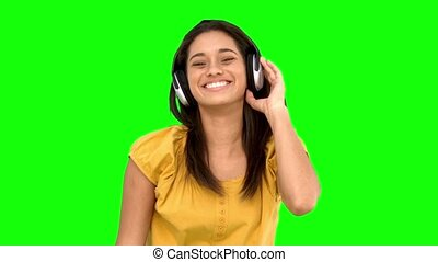 Woman smiling and listening to musi