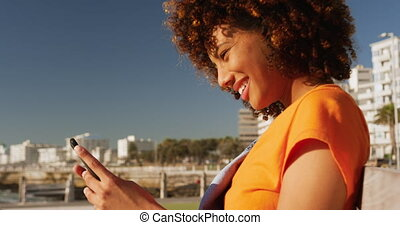 Woman smiling and using phone