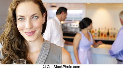Woman smiling at camera toasting with champagne