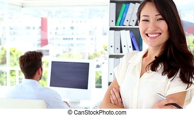 Woman smiling at camera while coll