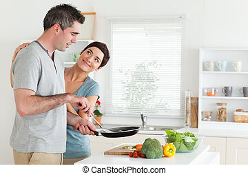 Woman smiling at her husband