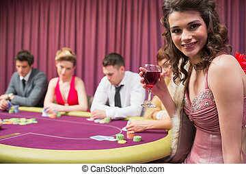 Woman smiling at poker table