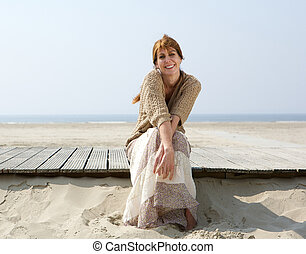 Woman smiling at the beach in summer