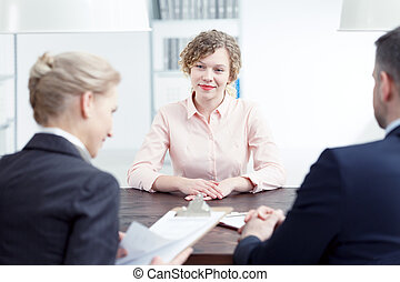 Woman smiling during recruitment review